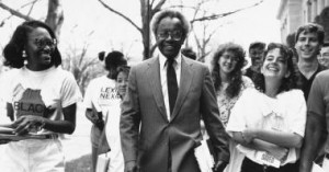 Derrick Bell walking with a group of Harvard Law School Students after taking his voluntary leave of absence.